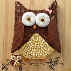 Super cute Owl Cake. I love how they used donuts for the eyes and almonds for the body! More adorable cakes: http://www.bhg.com/party/birthday/cake/birthday-cakes-and-cupcakes-for-girls/