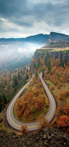 'Tight Corner' - Autumn colors surround a hairpin turn coming down from Rowena Heights in Oregon #Oregon by Mike Dawson