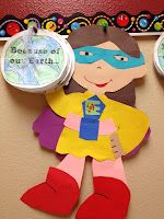 earth day superhero with book