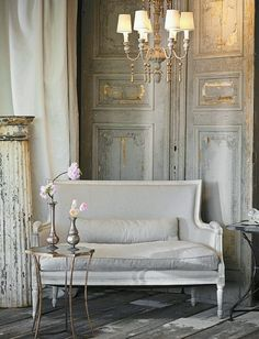 French Inspired Shabby Chic! This is gorgeous to look at....the color palette, the architectural pieces and chandelier create a breathtaking vignette filled with beauty, charm and texture!