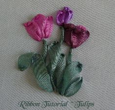 I ❤ ribbon embroidery . . .  Simply constructed in Ribbon Stitch, the effect of the petals are changed by using Side Ribbon Stitch. Instead of taking the needle through the centre of  the ribbon, place the eye of the needle on the left or right seam of the ribbon. As the needle is pulled through the ribbon curls toward the entry point, thus giving the petal a slight rolled edge. As with Iris the leaves are stitched in the same manner. With a fold, curled, straight, or twisted.