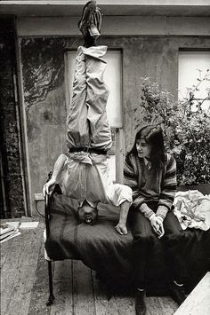 Lucian Freud standing on his head in his studio with his daughter, the fashion designer Bella Freud, pictured in 1983