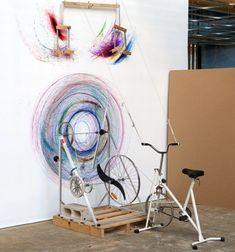 """Artist Joseph L. Griffiths has devised a bicycle-powered drawing machine which creates colorful gyroscopic patterns of varying sizes on walls with the turn of a set of pedals. Per Neatorama, """"His interactive installations explore man's relationship with machines and involve the audience in the creative cycle."""""""