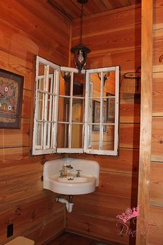 Old windows with mirrors added make a great vanity for half bath