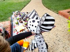 Black and White ribbon in stripes and polka dots will add a punch to this bright orange garland!