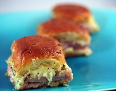 Dinner Roll Sandwiches | these are good, but they just taste like ham and cheese on Hawaiian rolls. Can't tell the sauce really adds anything.