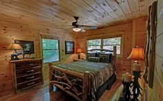 Rustic log cabin furniture.  Love the lamps and candle holders!