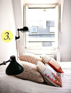 Choose wall lights as bedside lamps to save space in small bedrooms.
