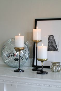 Entertaining for Beginners: Host a Game Night // mirror ball // black and gold candle holders