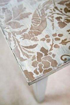 Revamp that old coffee table with a cool stencil and a bit of paint!
