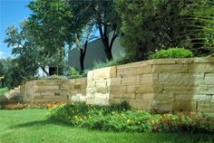 Never seen such interesting geometric angles used as a retaining wall before, but this really works. Elegant design solution from Mills Brothers Landscape & Nursery in Fort Collins, CO.