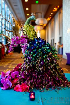 Peacock of Orchids Tablescape Centerpiece www.tablescapesbydesign.com https://www.facebook.com/pages/Tablescapes-By-Design/129811416695