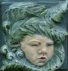 Clay Relief Sculpture Cherub in the Ferns