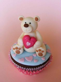 Adorable Teddy Bear #Valentine #Cupcake We love! Super cute! :-) Aw! He's holding a love heart!