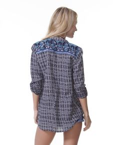 Our adorable long sleeve woven button up and oversized front pockets.