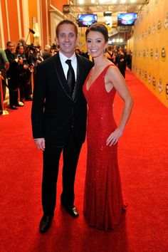 LAS VEGAS, NV - NOVEMBER 30: Greg Biffle, driver of the #16 3M Ford, and his wife Nicole arrive on the red carpet for the NASCAR Sprint Cup Series Champion's Awards at the Wynn Las Vegas on November 30, 2012 in Las Vegas, Nevada. (Photo by Jeff Bottari/Getty Images for NASCAR)