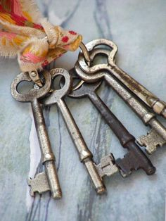 Vintage skeleton keys tied up with ribbon.
