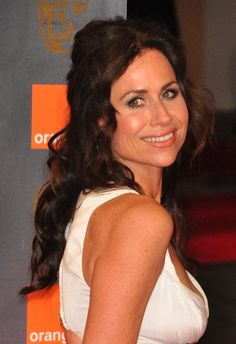 Minnie Drivers partial updo hairstyle