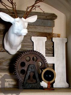 rustic industrial: deer head from decor steals or antique farmhouse, the other pieces are hobby lobby