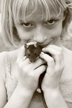 Little girl with mouse