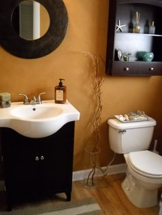 Half bath, This half bath was designed on a budget, I got the vanity for only $80, wall cabinet for $14, mirror, $12, blinds, $10, even the flooring was very cheap and i painted it myself with Ralph Laurens suade faux finish., Bathrooms Design