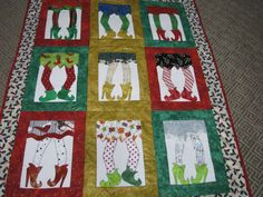 "Gorgeous & Fun Christmas Elf Shoes~Appliqued & Quilted Wall Hanging"" BY silverqueens @Etsy: SOLD. This is a beautiful wall hanging quilt with elf shoes as the theme. A fun addition for your holiday decorations. It measures 34"" wide by 44"" long & is made with 100% cotton. The applique thread is cotton, rayon & metallic. Bright & cheerful, it will be the center of attention in any home & bring joy to all those who love having little elves around during the season..."