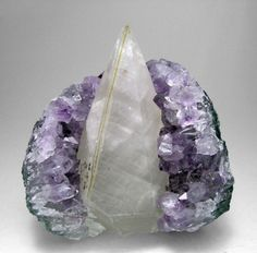 Clear Quartz wrapped in a Amethyst Cluster...Pure Magic!