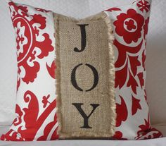 add a burlap holiday sentiment to one of your existing pillows-would be awesome if you could make it wrap around the pillows so you could change out the burlap according to the season, etc.