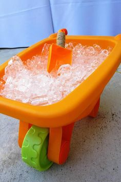 wheel  barrow filled with ice for drinks and to keep things cooled. themed birthday parties, ice cubes, drink, construction party, 1st birthday, construction birthday ideas, parti idea, themed parties, wheel barrow