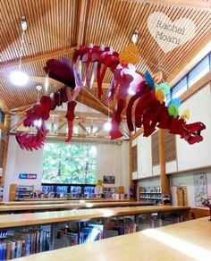 A Dinosaur Moves into the Library - Still Under Construction - Dig Into Reading Décor - Kids Decorated all the Plates on our Life Size Stegosaurus