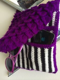 Purple Striped Crossbody Purse Pattern. This purse is a must! Everyone will be asking you where you got it, then when you tell them that you made it you will be a star. It features the famous crocodile stitch on the lid with many hidden striped many pockets inside.