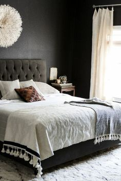 black walls + white bedding.