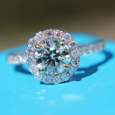 Wouldn't mind having one of these: 1.25 carat Round - Halo - Pave - Antique Style - Diamond Engagement Ring 14K