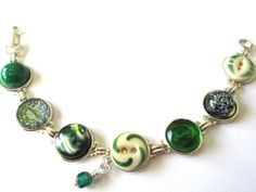 Antique button bracelet. RARE china stencil button in center. 1800s buttons. China and glass buttons
