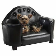 """Sofa-shaped pet bed with tufted faux leather upholstery.   Product: Pet bed Construction Material: Faux leather Color: Black  Features:  Accommodates pets up to 15 lbs Furniture grade construction  Dimensions: 17"""" H x 27.75"""" W x 16"""" D  Cleaning and Care: Spot clean with a damp cloth"""
