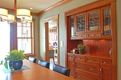 Modern Historic - The newly enlarged kitchen allowed space for a classic dining room with built in hutch that adds a strong yet graceful focal point to the room. The hutch was designed to match the kitchen cabinets and provide both visually open and closed storage spaces.