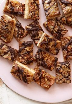 Ginger-Pecan Bars -- Cream cheese cake topped with a sweet ginger sauce and drizzled with chocolate. Meet your new favorite dessert recipe.