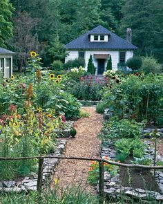 Flowers and veggies. http://www.marthastewart.com/275232/garden-tour-an-edible-landscape/@center/276999/home-tours#/223377 garden tour, edible garden, sunflower gardens, front yards, rais bed, vegetables garden, edibl landscap, garden beds, veget garden