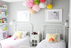 Love this. Gray walls, pops of color in puffs, book, love open book shelf, photos, white iron headboard