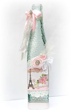 Spruce up a vase, or in my case an old wine bottle, with scrapbook paper, ribbon and lace!