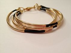 Black and Gold Layered Bangle Bracelet by PennyChicDesigns on Etsy