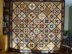 """My last Quilt Along quilt.The blocks are set on point and I used alternating Alabama Variation (EQ7) blocks. All the instructions for this quilt are still available on my blog. The blocks are 9""""."""