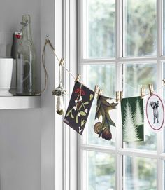 Great craft idea: for a charming, low-key display hang your holiday cards across windows using clothes pins and twine as you receive them?