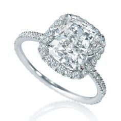 Micropave cushion-cut engagement ring in a platinum setting from Harry Winston.