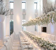 super chic white decor table settings, rehearsal dinners, bud vases, hanging flowers, modern weddings, harry potter, white weddings, wedding centerpieces, long tables