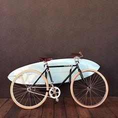 This custom Roadster Classic went out to a lucky client of @raptstudio and included cream tires, @brooksengland saddle and grips, a brass bell, and surf rack. #shakamobile
