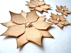 These are cute little Christmas ornaments for a little pressie!!  Paper Poinsettias, Vintage Peach, Christmas, Decor, DIY, Baby Girl First Christmas, Handmade Embellishments, Set of 4, Ready To Ship. $5.00, via Etsy.