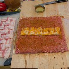 (SMOKER RECIPE) Roll or pat out the ground beef to the same size shape as the bacon weave. Lay the cheese along the middle of the square of ground beef. Spread the BBQ spice rub across all the beef. Recipe for the spice rub is found here.