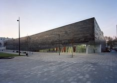 This tilting sports centre has a multi-hued basalt facade and a faceted roof garden.