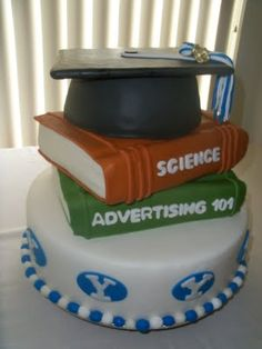 @Stephanie Fraser for Alex's graduation cake, minus the books, plus medical signs (like a red cross)   on the cake?